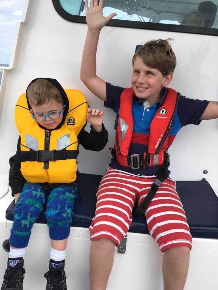 Two boys on a boat