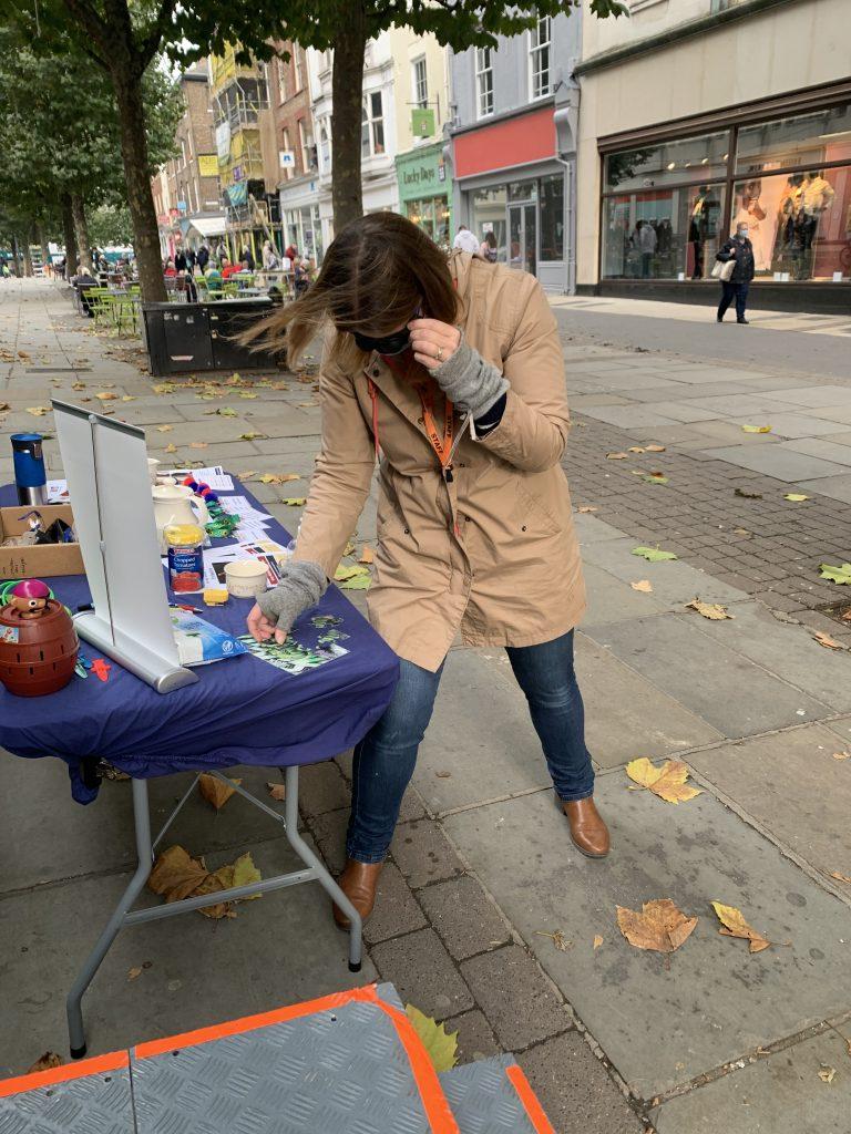 Helen demonstrating vision impairment glasses