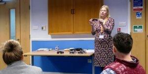 Julie holding sensory awareness training